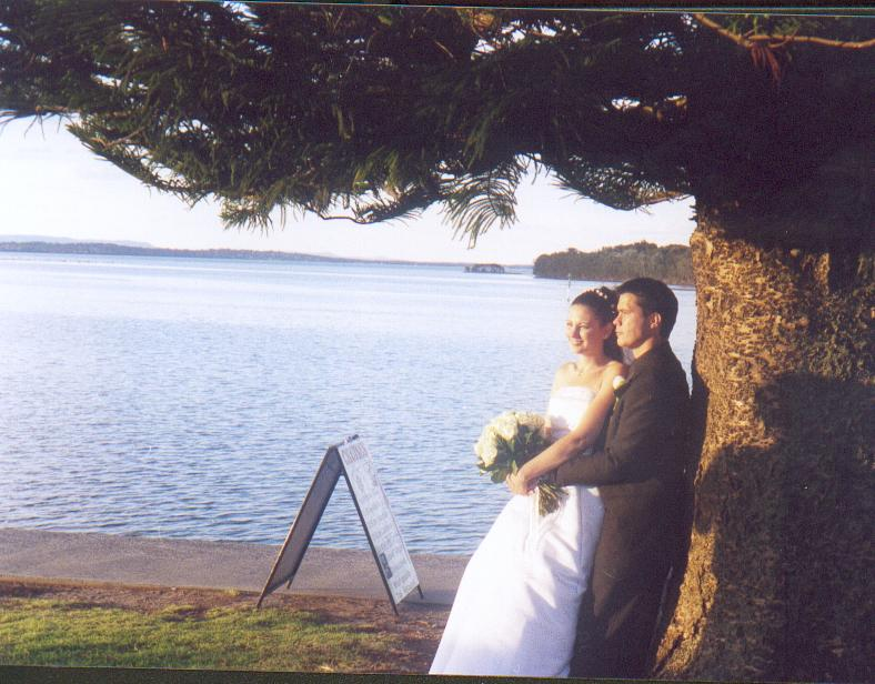 A bride and groom leaving church; Actual size=180 pixels wide